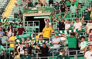 Celtic fans watching their team at Celtic Park