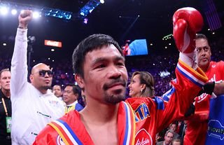 Manny Pacquiao raising his fist to the crowd