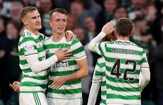 Celtic players congratulate David Turnbull after he scored against Jablonec