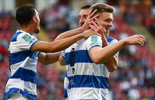 Rob Dickie celebrates after scoring for QPR against Leyton Orient