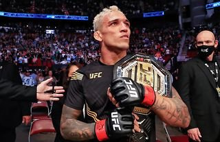 Charles Oliveira is in talks to defend his lightweight title against the in-form Dustin Poirier, according to reports.