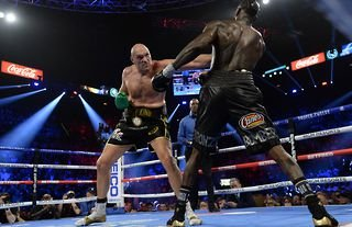 Tyson Fury in action against Deontay Wilder in America during their second fight