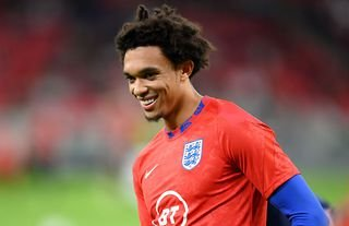 Trent Alexander-Arnold warms up for England against Hungary