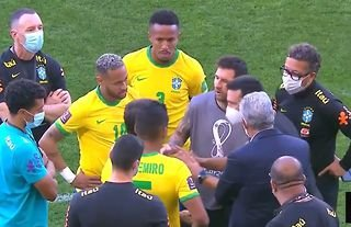 Lionel Messi chatting to a health official during Brazil v Argentina chaos