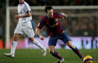 Andres Iniesta playing for Barcelona against Real Madrid in 2007