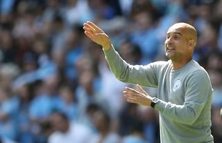 Man City manager Pep Guardiola giving instructions to his players