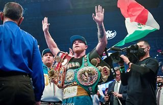 Canelo with the Super-Middleweight titles