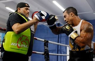 Vitor Belfort's coach Derik Santos admits he is unsure what to expect from Evander Holyfield.