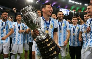Lionel Messi with the Copa America trophy