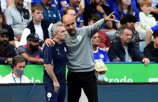 Man City manager Pep Guardiola with his coaching staff