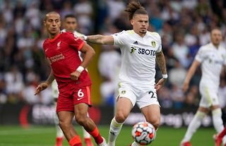 Liverpool star Thiago is tackled by Leeds United midfielder Kalvin Phillips at Elland Road