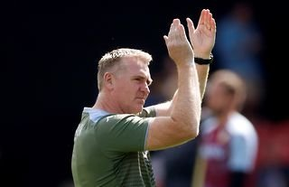 Aston Villa manager Dean Smith claps the club's supporters