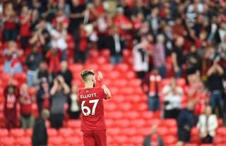 Liverpool teenager Harvey Elliott claps the club's supporters