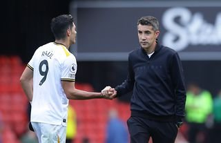 Wolves manager Bruno Lage shaking hands with Raul Jimenez