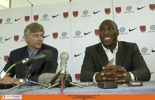 Arsene Wenger and Sol Campbell at a press conference
