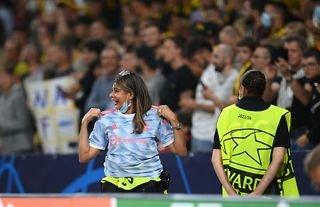 A security guard at Young Boys gets Cristiano Ronaldo's shirt after being knocked down by a shot in the warm-up