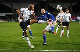 Cardiff City defender Ciaron Brown tackles Swansea striker Andre Ayew