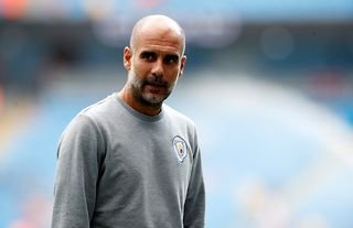 Man City manager Pep Guardiola in his club tracksuit