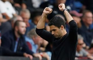 Arsenal manager Mikel Arteta punches the air in celebration