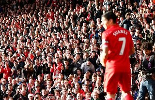 Luis Suarez prepares to take a corner for Liverpool at Anfield