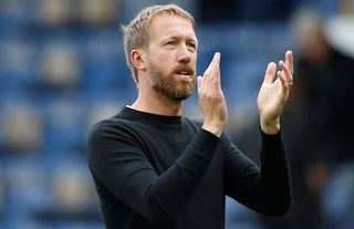 Brighton manager Graham Potter claps the fans