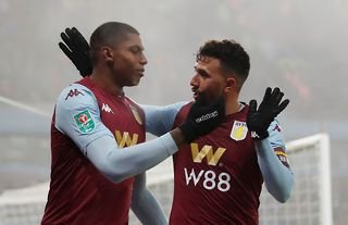 Wesley embraces his Aston Villa teammate during his time at the club