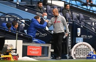 Thomas Tuchel and Pep Guardiola embrace before Manchester City play against Chelsea in the Premier League at The Etihad Stadium