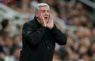Newcastle manager Steve Bruce giving instructions to his players