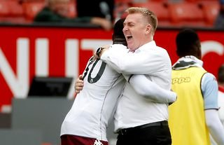 Aston Villa manager Dean Smith celebrating with Kortney Hause at Old Trafford