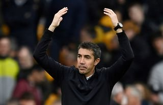 Wolves manager Bruno Lage raises his arms in celebration after recent win