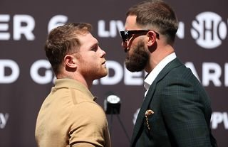 Canelo Alvarez faces off with Caleb Plant during their pre-fight press conference.