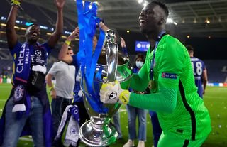 Mendy celebrates winning the Champions League with Chelsea.