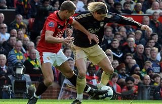 Vidic and Torres do battle during a Man Utd vs Liverpool clash.